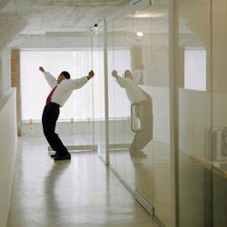 Businessman Celebrating in Hallway